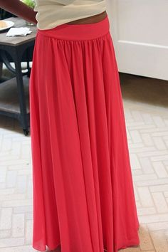 This gives you a pattern to make your own maxi skirt. Since I can't find a hot pink one anywhere, I may have to do this....
