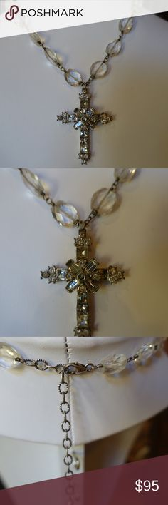 Beautiful Crystal Cross Necklace Its hard to capture the beauty of this necklace on camera.  Stones around neck are clear crystal and cross is beautifully detailed Crystal stones.  Can adjust length.    Cross is about 2 inches in size.  Length of necklace approx 7 to 9 inches long. Unknown Jewelry Necklaces