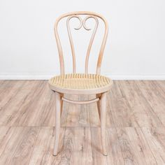 This candy cane bentwood chair is featured in a curved wood with a light white washed wood finish. This iconic bistro chair has a curved candy cane back and a round woven cane seat. Perfect accent chair for a small space! #americantraditional #chairs #accentchair #sandiegovintage #vintagefurniture