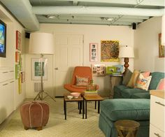 Family Room Decorating Ideas Inexpensive way to finish basement ceiling – just paint it out in a neat color. Cozy Family Rooms, Family Room Decorating, Family Room Design, Cozy Living Rooms, Living Room Decor, Decorating Ideas, Basement Decorating, Dining Room, Cozy Basement