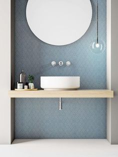 Love the tile with the circular mirror and pale wooden vanity. Clear, single globe light and cute tray of bathroom essentials. Very crisp. Love the tile with the circular mirror and pale wooden vanity. Clear, single globe light and cute tray of Bathroom Interior, Home Interior, Decor Interior Design, Interior Decorating, Decorating Games, Decorating Websites, Mid Century Interior Design, Color Interior, Simple Interior