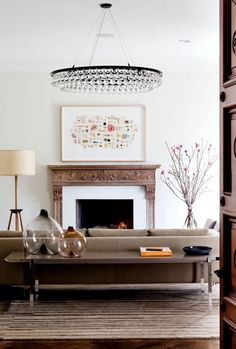 Starkly elegant and yet not cold. I'm admittedly intrigued by the *whateverthatis* over the fireplace...