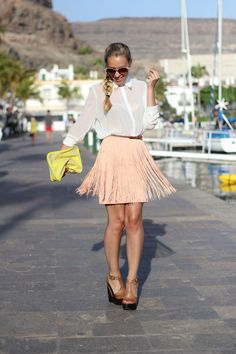 Another fashionable style this season is fringe! This fringed pastel pink skirt has lovely dimension and style.