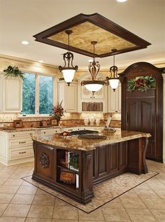 eye catching! elegant island and light fixtures :) I love the refrigerator as well! I like the cream cabinets, if they were dark the island and fridge wouldn't showcase...and the place would seem dark. Old World Kitchen Island and kitchen remodel