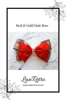 A stylish red and gold hand-crafted hair bow made from quality satin ribbons and a sparkly diamante embellishment. Perfect for special ocassions such as Christmas, weddings, birthday parties or photo shoots. It has an uncovered alligator clip attached to the back so it can be placed securely in the hair. Approx length 3ins/8cm x Width 5.5ins/13.5cm Gold Hair Bow, Satin Ribbons, Handmade Hair Accessories, Making Hair Bows, How To Make Bows, Red Gold, Crowns, Small Businesses, Headbands