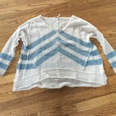 Sweater Gorgeous, never worn, off-white and dusty aqua, slightly flared shape, raised exposed seams, like new, no tags, gift I have never worn. Free People Sweaters V-Necks