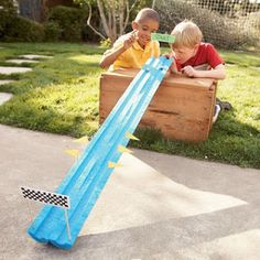 50 Outdoor Summer Activities For Kids | Split a pool noodle for marble racing