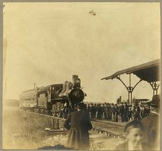 Train pulling into a small town station, ca. 1900s by Missouri History Museum, via Flickr