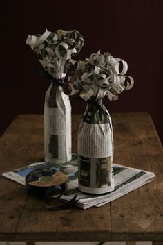 wrap a wine bottle with newspaper and just curl the ends like ribbon