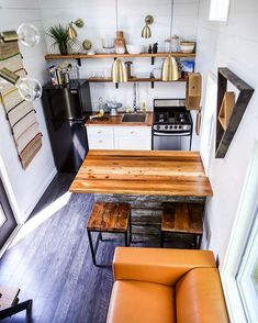 Tiny House Giveaway by Lamon Luther – Tiny Living This 368 sq. tiny house features a full kitchen with a beautiful reclaimed wood island that doubles as a table, a freestanding range, and apartment-size refrigerator. Tiny Studio Apartments, Studio Apartment Layout, Apartment Design, Studio Apartment Kitchen, Apartment Ideas, Apartment Furniture, Apartment Therapy, Studio Apartment Organization, Tiny Apartment Decorating