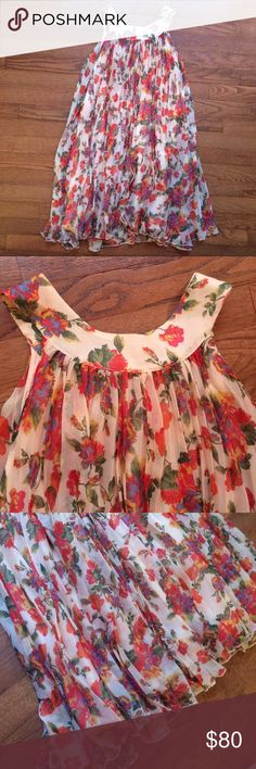 Free People floral swing dress So much flounce going on here! Gorgeous dress! High choker collar buttons in back, low arm holes, lots of movement and so romantic! Free People Dresses
