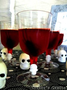 Grab a bag of Halloween themed rings at the Dollar Store and plastic goblets with removable bases and.... viola! bloody genius party ideas!