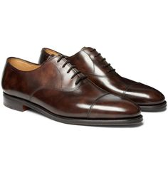 John Lobb Oxford shoes belie the complex processes that go into making them: with over 190 steps, many of them completed by hand, each pair is a unique example of superior British craftsmanship. The slightly mottled brown leather is selected for its smooth appearance and soft feel, and should last a lifetime if cared for properly.