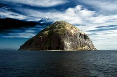 Ailsa Craig is an island in the outer Firth of Clyde, upon which blue hone granite was quarried to make curling stones. The now uninhabited island is formed from the volcanic plug of an extinct volcano. The island. Edinburgh, Glasgow, National Geographic, Curling Stone, Reserva Natural, West Coast Scotland, Scottish Islands, British Isles, Beautiful Pictures