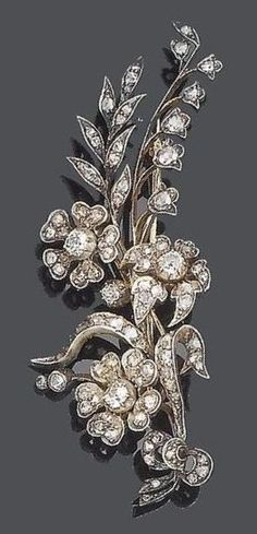 A late 19th century diamond spray brooch/hair ornament, circa 1880. The tied bouquet of leaves and blooms set throughout with old brilliant and rose-cut diamonds, mounted in silver and gold, old brilliant-cut diamonds approx. 0.45ct. total, the pin fitting can be substituted with the two provided hair pins.
