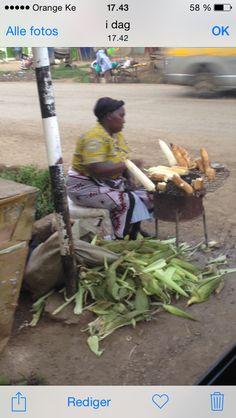 Local woman selling maize