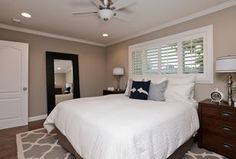 Cottage Master Bedroom with Carpet, Hardwood floors, Crown molding, flush light, High ceiling, Ceiling fan
