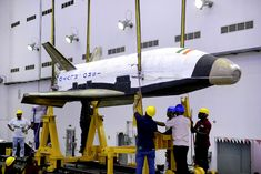 Nasa The RLV-TD is relatively tiny. Its length makes it much, much smaller than NASA's retired fleet of space shuttles. - It's the country's first shuttle, and it landed successfully. Isro India, First Space Shuttle, Indian Space Research Organisation, Plane Design, Aerospace Engineering, Launch Pad, Nasa Astronauts, Space Program, Space Travel