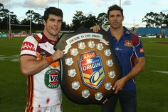 Country captain Michael Ennis and Country coach Trent Barrett pose with the shield after victory in the Origin match between City and Country at BCU International Stadium on April 21, 2013 in Coffs Harbour, Australia.