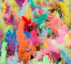 People throw coloured powder in the air during Holi festival celebrations in Berlin, Germany. Holi is celebrated in India and other Hindu countries where it heralds the beginning of spring. The Berlin event brought Indian DJs, acrobatics and dance to the German capital.