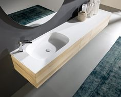 Naxani |   Tulip    Washbasin made with @krion by porcelanosa, an amazing material.