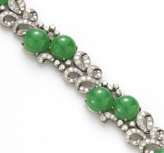 A jadeite jade and diamond bracelet  set with 13.0mm demi-beads and accented by full and single-cut diamonds; estimated total diamond weight: 5.40 carats; mounted in palladium
