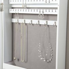 Photo Frames Wall Mount Jewelry Armoire Mirror - High Gloss White - x in. - When floor space is at a minimum, make jewelery storage easy by tucking everything inside the Photo Frames Wall Mount Jewelry Armoire Mirror - High. Diy Jewelry Armoire Mirror, Jewelry Organizer Wall, Diy Mirror, Jewelry Organization, Diy Clothes Hanger Rack, Jewelry Closet, High Jewelry, Diy Schmuck, Frames On Wall
