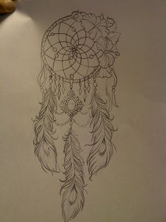 Dream catcher with peacock feathers