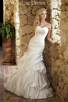 Ella Bridals 5655 is a Sophisticated Dolce Satin Fit and Flare A-Line Gown with Sweetheart Neckline, Pleated Bust, Beautiful Beaded Embellishment on Empire Waist, Ruching Through Bodice into Pick-Ups Skirt, Court Train, Diamond Shape Cut-Out Back, Back Embellishment and Back Covered Button Close.