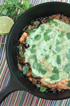 A cilantro avoado cream tops with one-pot quinoa and chicken enchilada skillet. Healthy, easy, and insanely delicious dairy-free dinner.