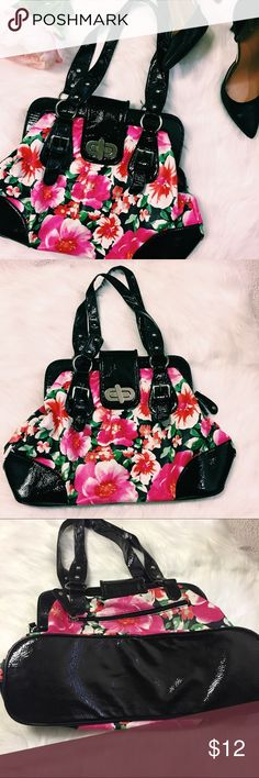 """Charming Charlie's floral bag Very bright floral bag. I loved this and used it a lot. The inside lining has makeup marks as pictured. I have not tried to clean it. Priced to sell. EUC on outside. Bottom- 15"""", height 10"""", straps- 10"""" Charming Charlie Bags Satchels"""