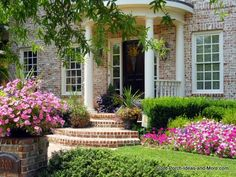 Brick porch and walkway with landscaping