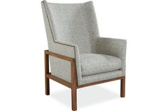 We have this chair in a beautiful grey on ivory trellis pattern with gun metal nail head and are about to present it for an Arts and Crafts style home project.  It has a fantastic exposed wooden frame which cradles the upholstered section of the chair (ottoman is also available).  Perfect for a study, fire-side, or reading chair ~ we LOVE LOVE LOVE.  Lee Industries 1978-01 Chair