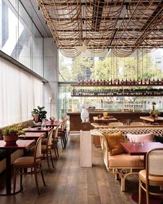 High ceilings and lots of natural light are on most people's property wishlists, but the soaring heights in some commercial buildings can mean a lot of negative space. In this Sydney restaurant, @alexander_andco have made great use of their lofty environs with a sculptural ceiling installation.