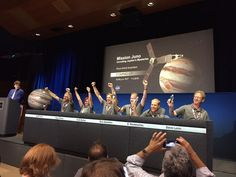 NASA officials and members of the Juno mission team celebrate the spacecraft's successful arrival at Jupiter on July 4, 2016.