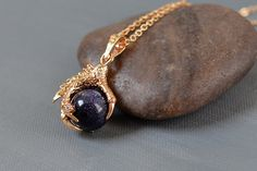 Gold Plated Dragon Claw Blue Sand Stone Gemstone Sphere Bead Pendant on Black Leather Cord
