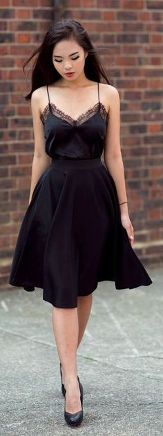 This statement black laced dress looks uber cute with matching black heels. With a sweater