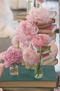 co - ordinate stacks of colour coordinated vintage books with peonies or david austin roses in vintage vases for a focal piece.