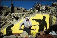 West Bank, 2002 - Digging out the ruins of a shop in Jenin refugee camp.