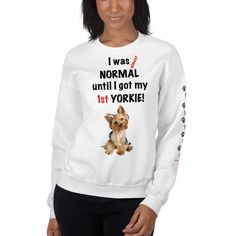 A sweatshirt for women Yorkshire Terrier mom and parent from our new collection, Almost normal, with paws design on the left sleeve.