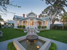 Lovely pathway entrance to white painted wooden Edwardian style 4 bedroom 1907 home @ Stanley Point Rd, Devonport. Lovely intricate fretwork around posts and eaves of the roof. Modern fountain (in Oct