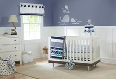 Just Born High Seas Wall Decals, Navy. Decorate your nursery with a nautical theme featuring cute whales. Coordinates with Just Born's High Sea's nursery bedding collection. Decals come on sheet in variety sizes stickers; sizes range from 1.5 inches x 2.5 inches to 16 inches x 5.25 inches. They have self-stick adhesive that won't harm walls, which are removable and reusable; just peel and stick. Hanging instructions are included.