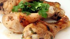 Broiled chicken thighs are brushed with a mixture of butter, soy sauce, and garlic.