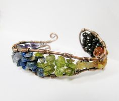 Hey, I found this really awesome Etsy listing at https://www.etsy.com/listing/178887401/chakra-gemstone-copper-wire-wrapped-cuff