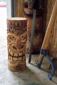 Woodworking Course A freshly made Tiki stares menacingly from the work area at Mai Tiki. Tree Carving, Wood Carving Art, Wood Art, Tiki Man, Tiki Tiki, Tiki Faces, Tiki Statues, Tiki Bar Decor, Tiki Totem