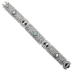 Art Deco Diamond Emerald Platinum Bracelet   From a unique collection of vintage link bracelets at https://www.1stdibs.com/jewelry/bracelets/link-bracelets/