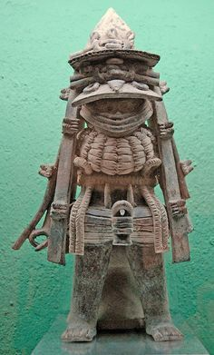 This ceramic statue of a man from the Veracruz area of Mexico shows him wearing an incredibly ornate costume. Was he a ruler? A warrior? Tamayo Museum -Oaxaca -Mexico p...