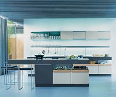 Simple poggenpohl kitchen with open cabinetry