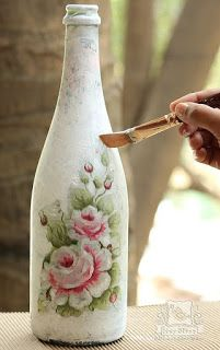 Decoupage is a traditional paper craft – the art of decorating an object by gluing colored paper cutouts. The word decoupage comes from the French verb decouper, 'to cut out… Glass Bottle Crafts, Wine Bottle Art, Painted Wine Bottles, Diy Bottle, Bottles And Jars, Decorated Bottles, Vintage Bottles, Vintage Perfume, Wine Bottles Decor