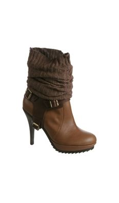 heeled boot with knitted ankle... Not usually my style but these are cute.